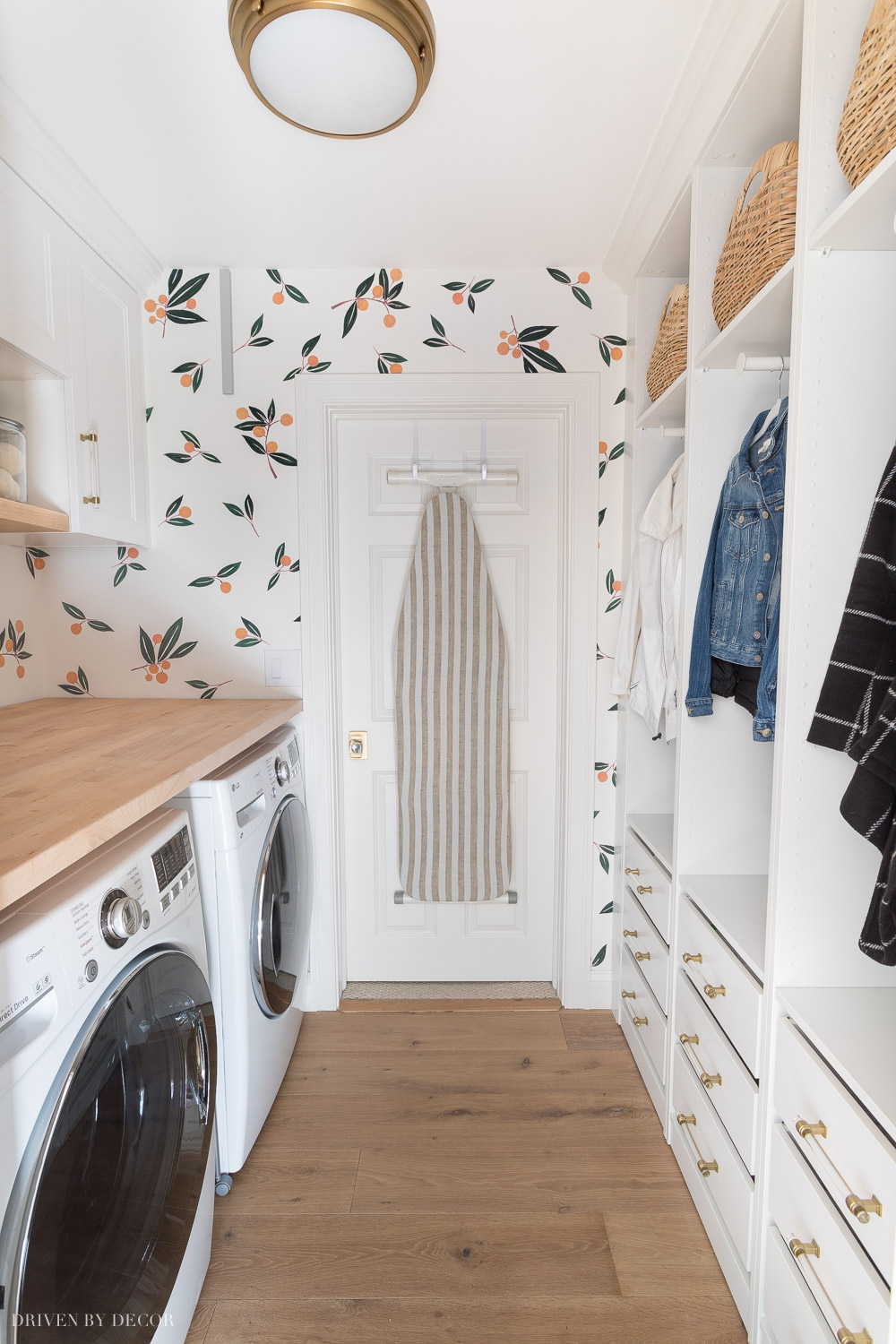 We transformed the look of our laundry room with Ikea cabinets and wardrobes!