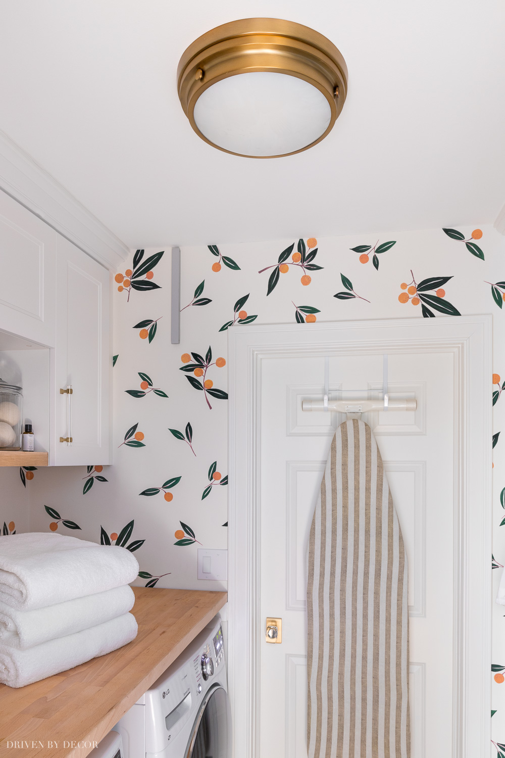 Love this simple but stylish flush mount ceiling light in our laundry room!