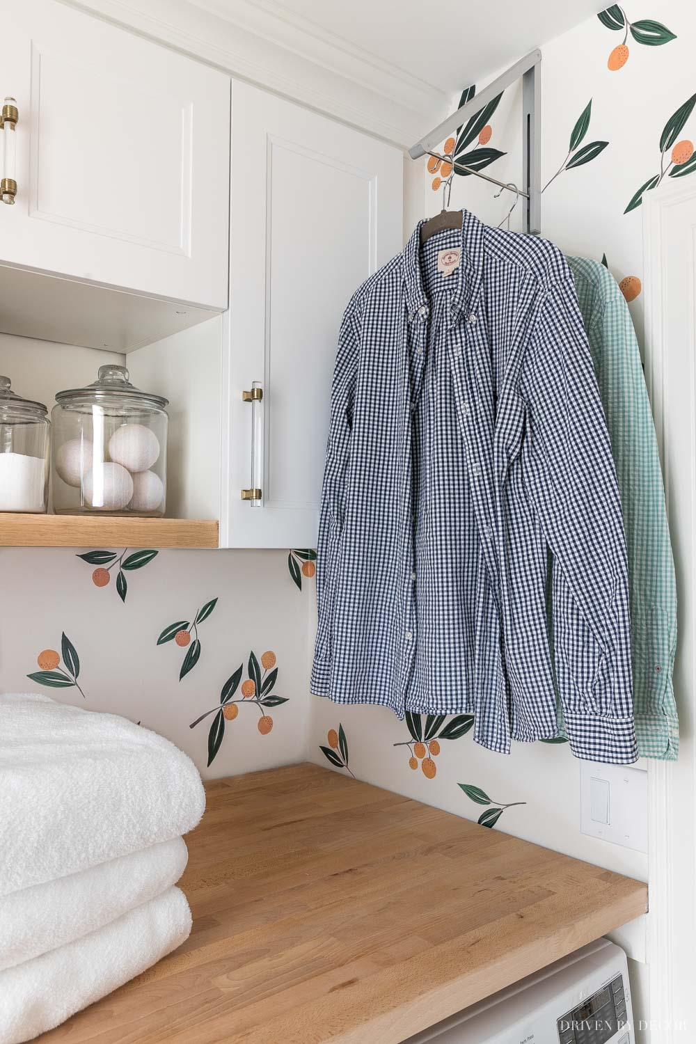 Love this retractable clothes rack for hanging clothes to dry in our laundry room!