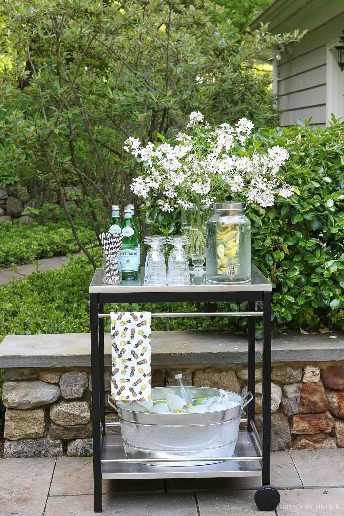 A bar cart for holding drinks while entertaining is one of my favorite outdoor decor ideas!