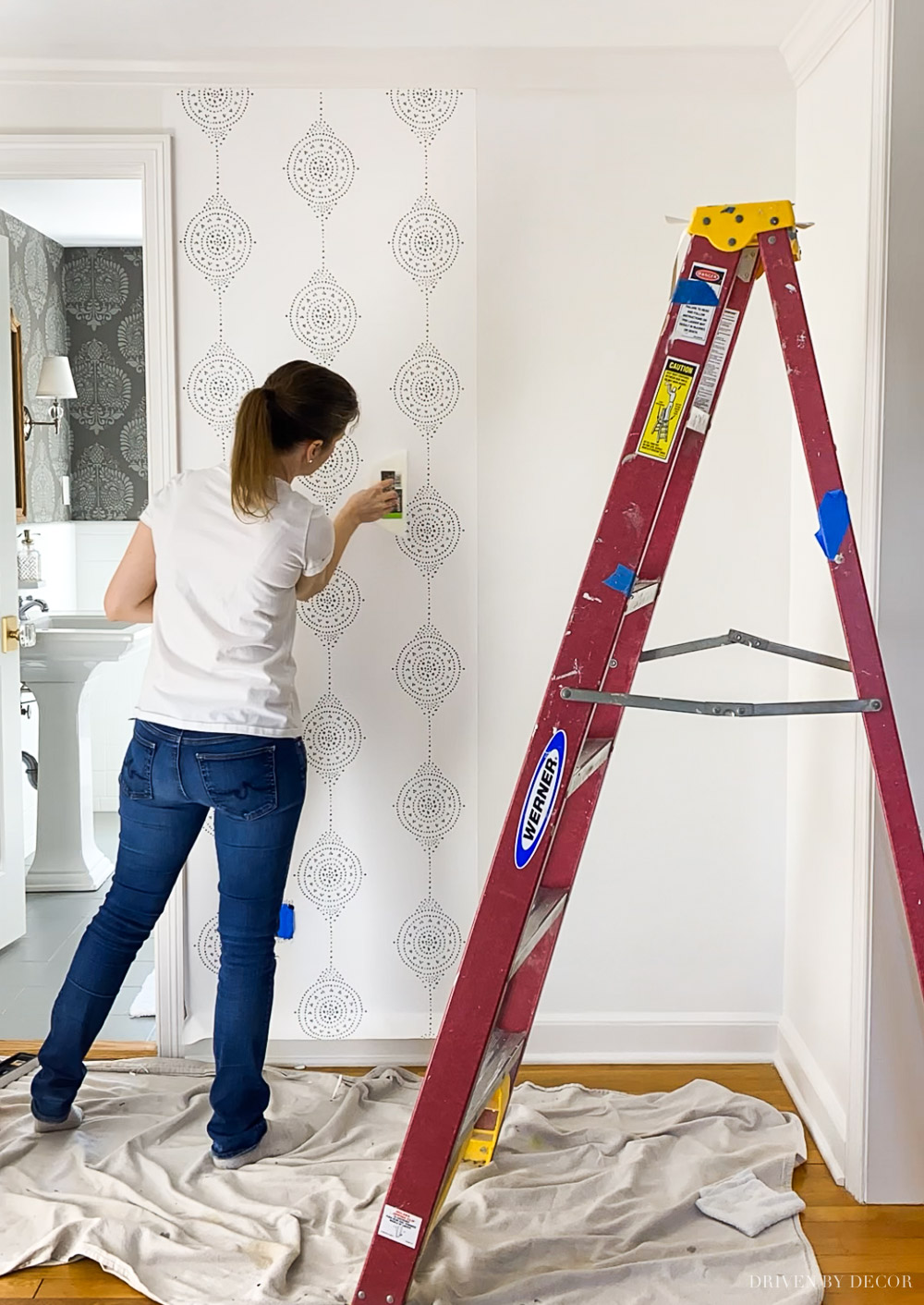 Entryway makeover starting with hanging new wallpaper!