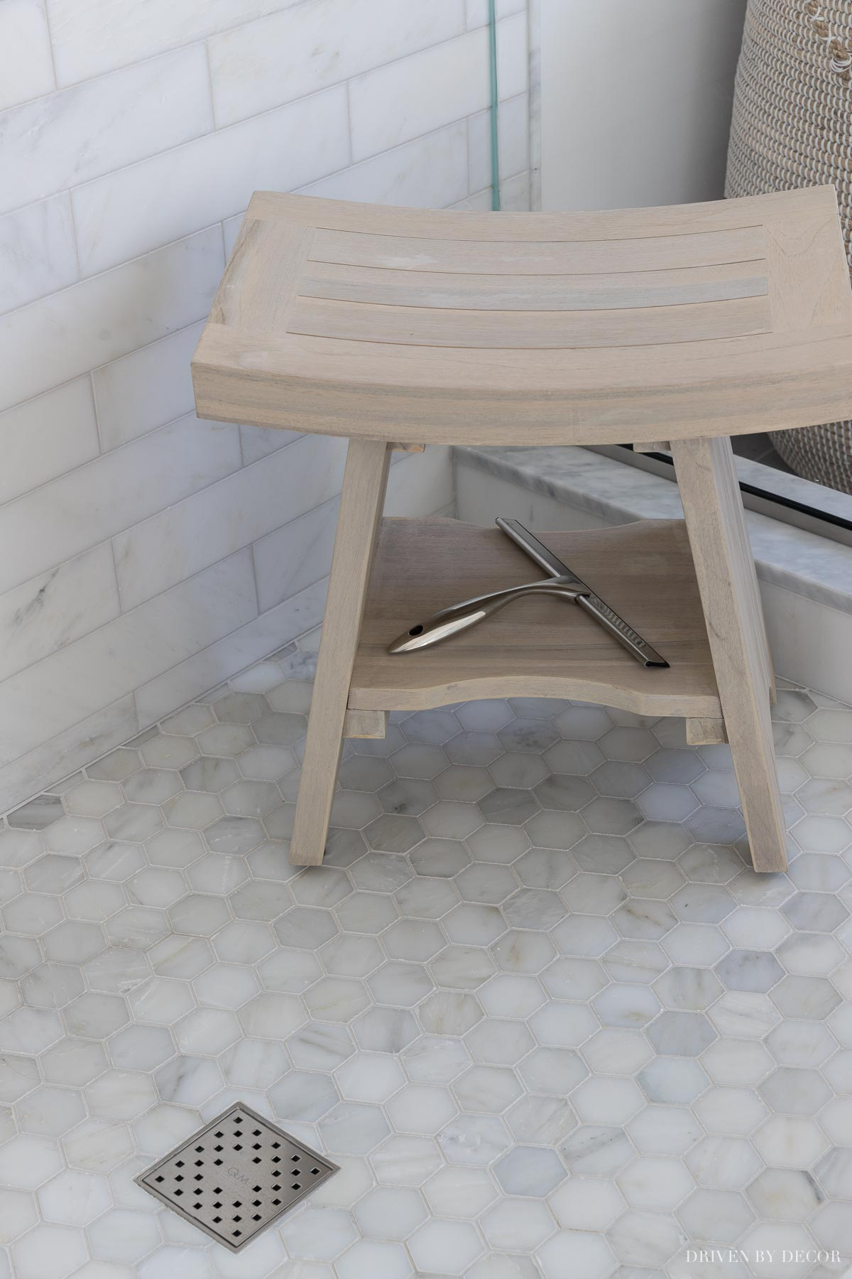 This squeegee is a must-have for keeping marble tile clean in bathrooms!