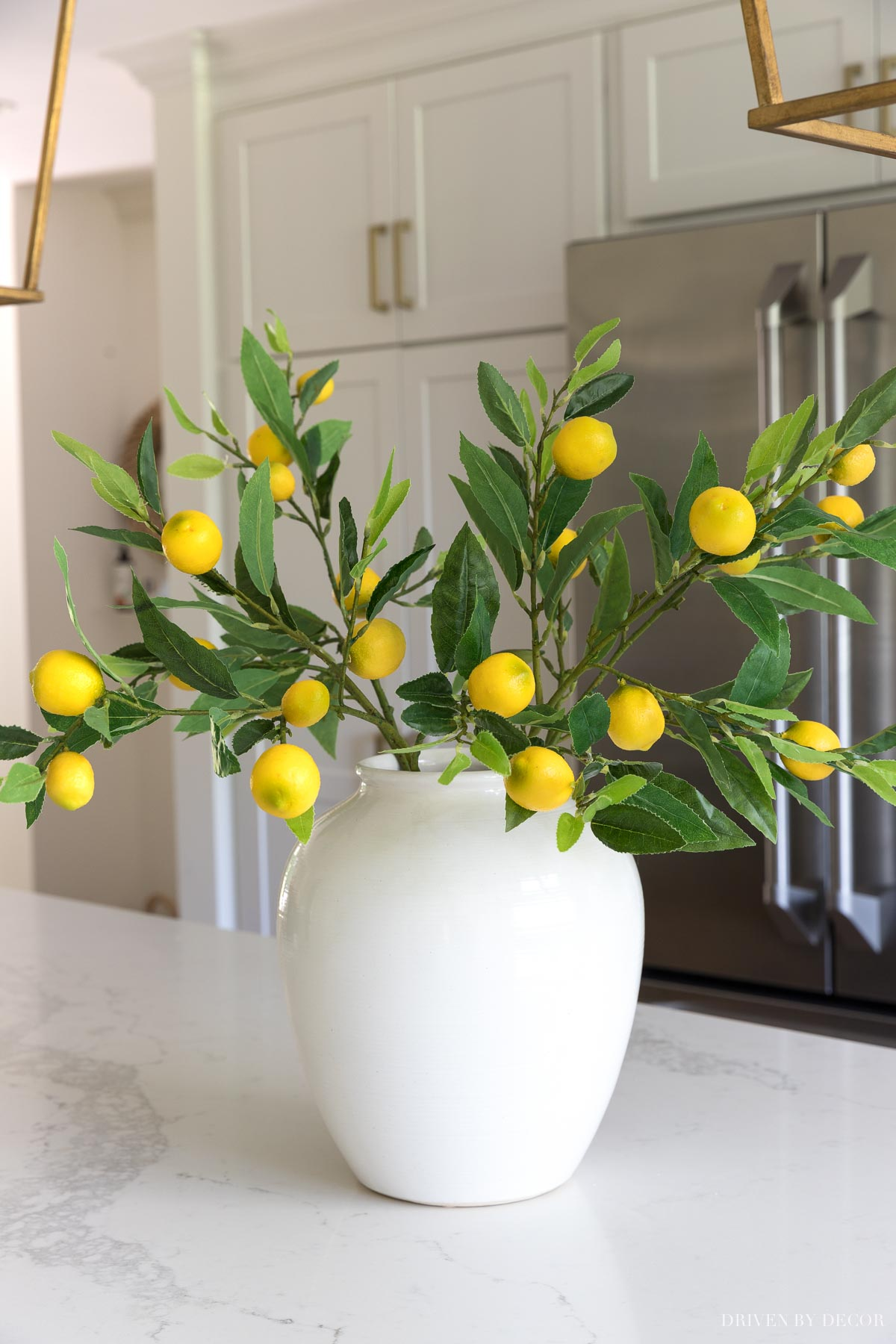 Love these artificial lemon branches! More on these and other great artificial flowers are in this post!