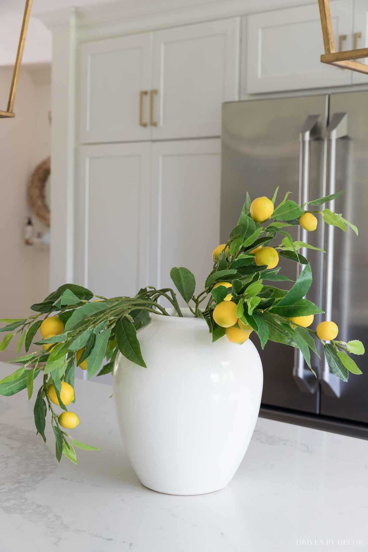 The key to making artificial flowers and branches look real is to fluff them up! Click to see the after!