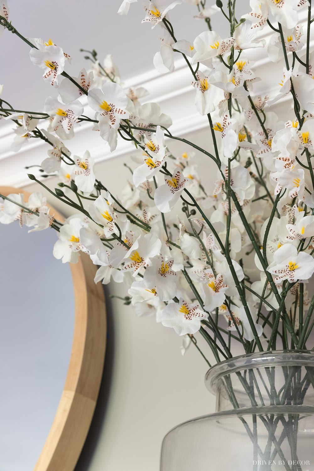 A close-up of the artificial flowers on our fireplace mantel - love!