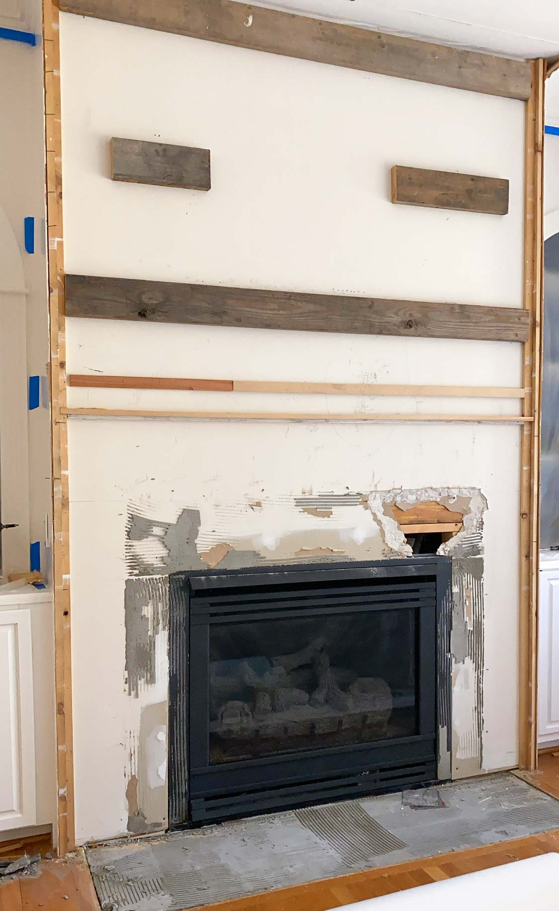 Removing the face of our fireplace to modernize the design