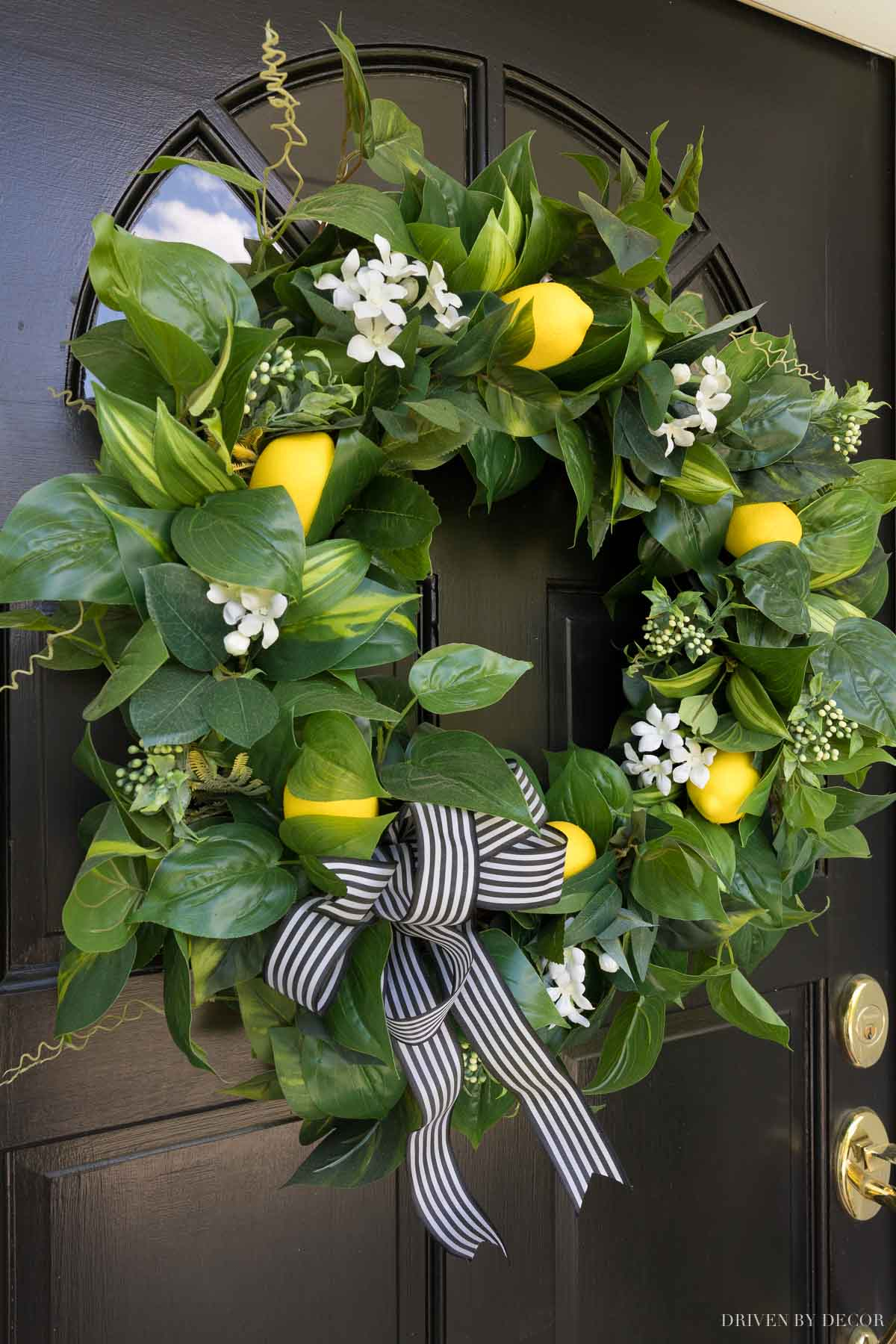 Our spring wreath with artificial greenery, flowers, and lemons!