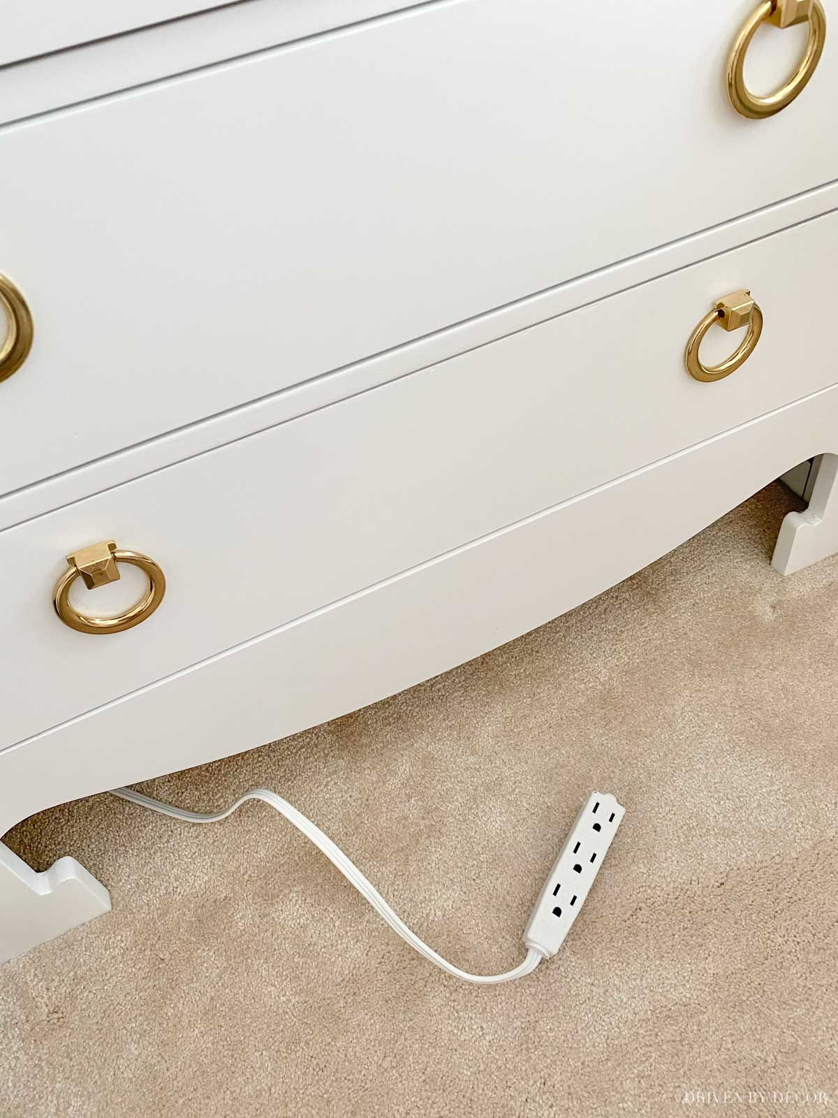 A simple solution for easy access to an outlet behind a piece of furniture!