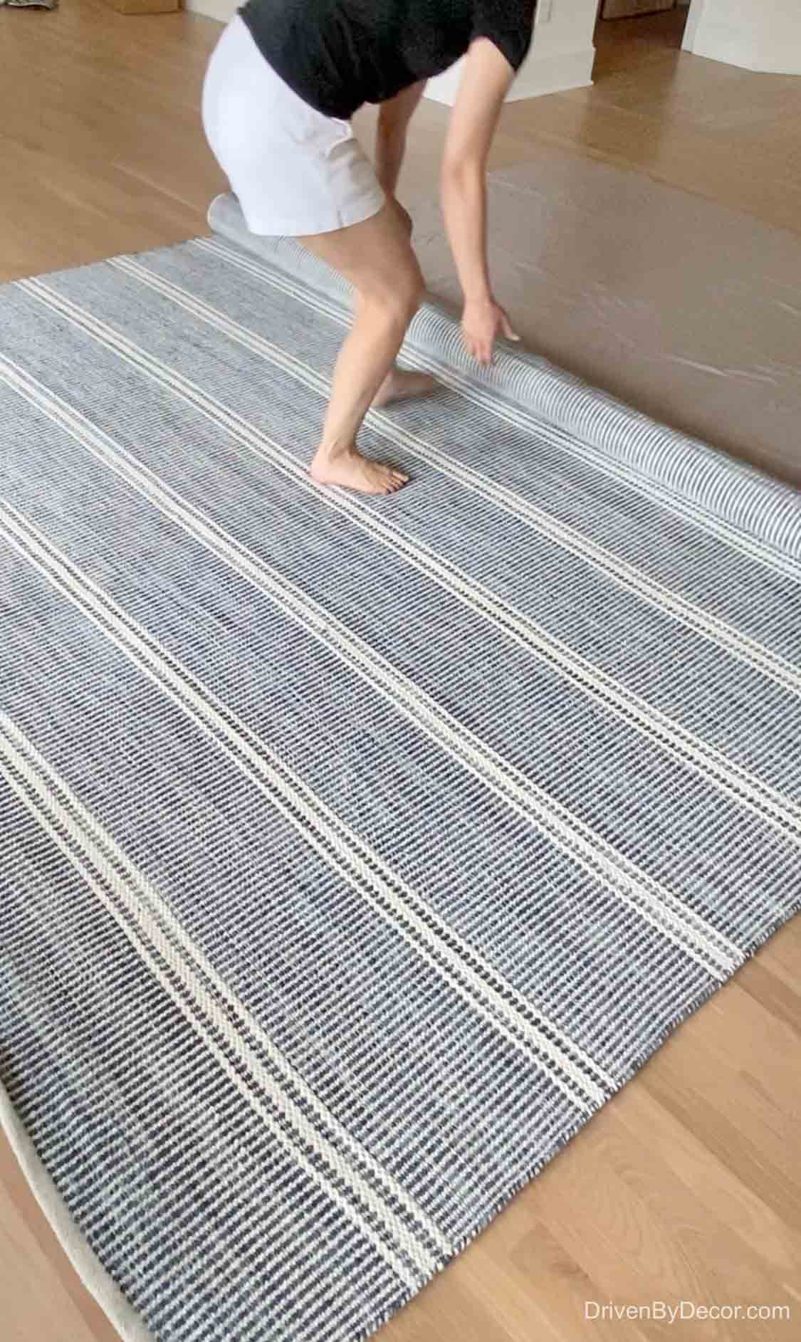 Rolling out our new blue and white family room rug!
