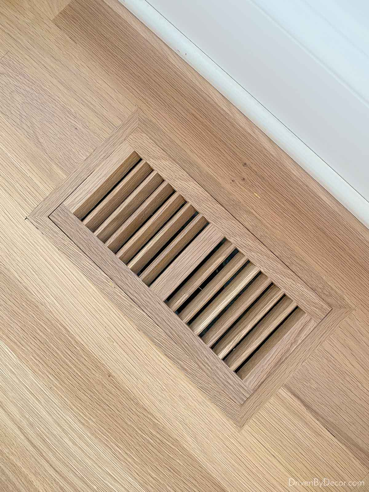 Custom wood floor vent as part of hardwood floor refinishing project