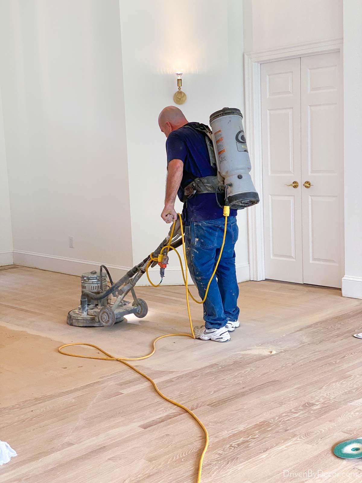 Dustless hardwood floor refinishing - sanding equipment is hooked up to a vacuum