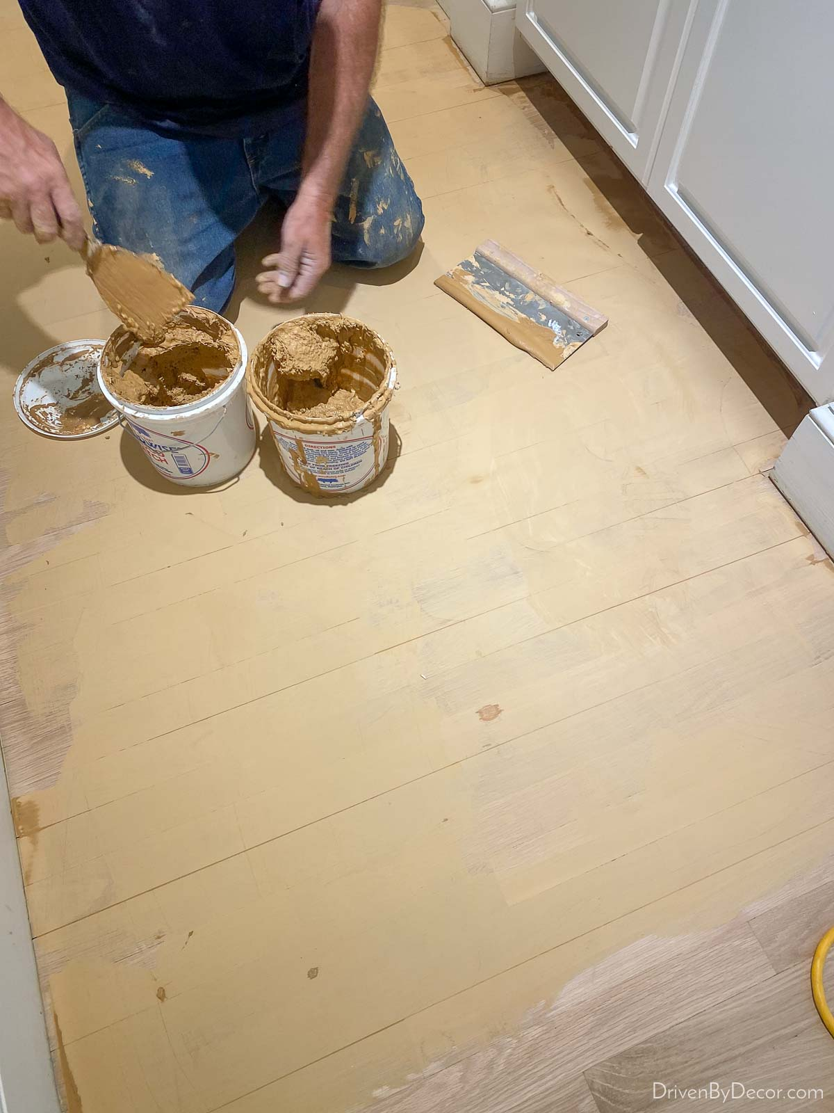 Applying wood filler to patch imperfections in wood floor before refinishing