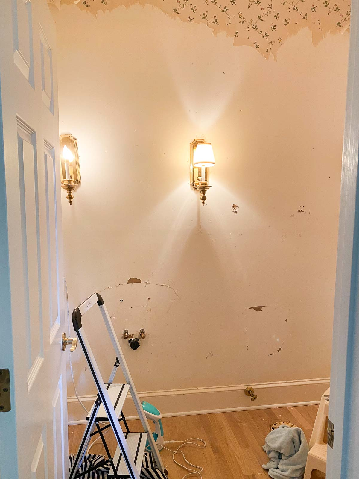 Removing wallpaper in our powder room