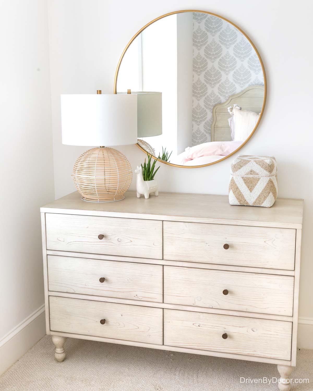 Round mirror over dresser