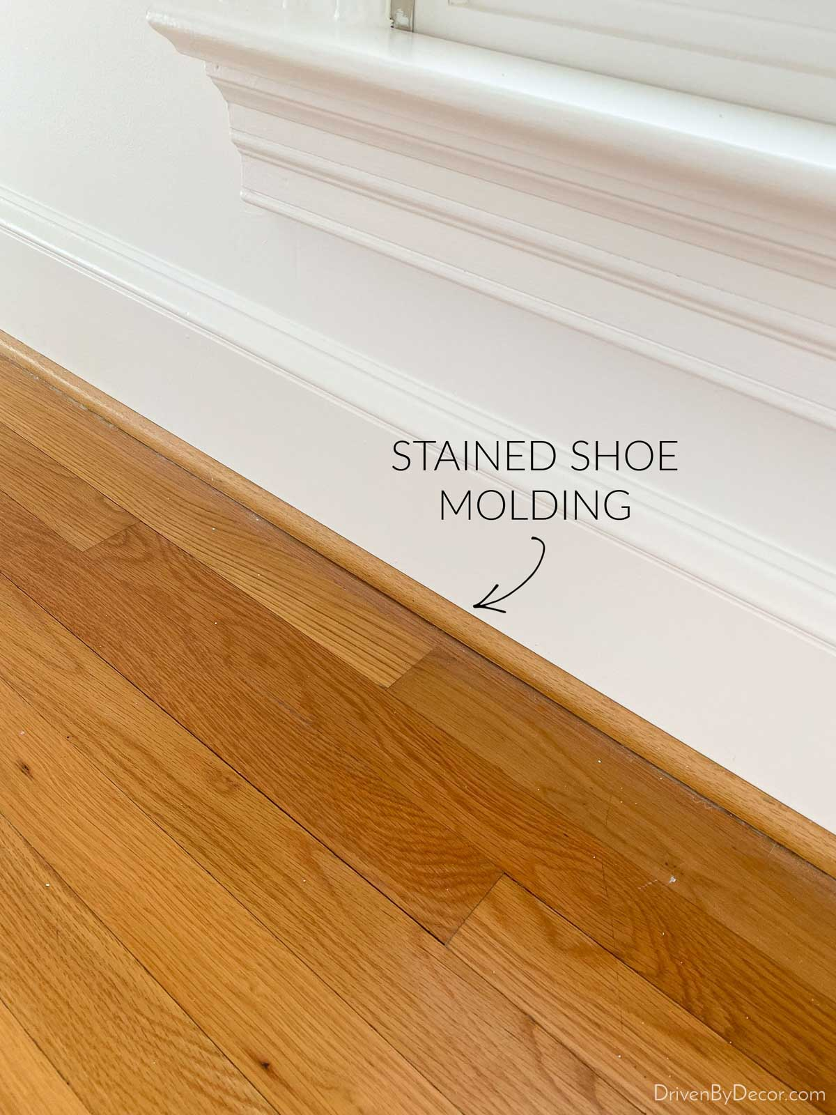 Hardwood floors with stained shoe molding