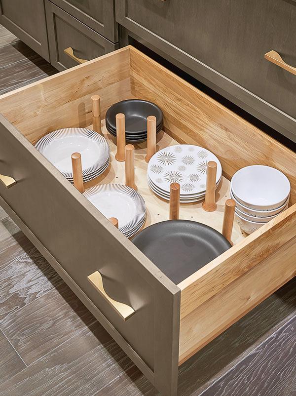 This kitchen peg board drawer organizer organizes pots, pans, & lids or dishes!