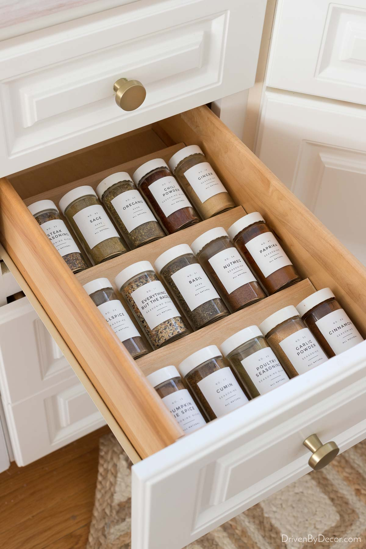 This wood kitchen drawer spice organizer makes your spices so easy to find!
