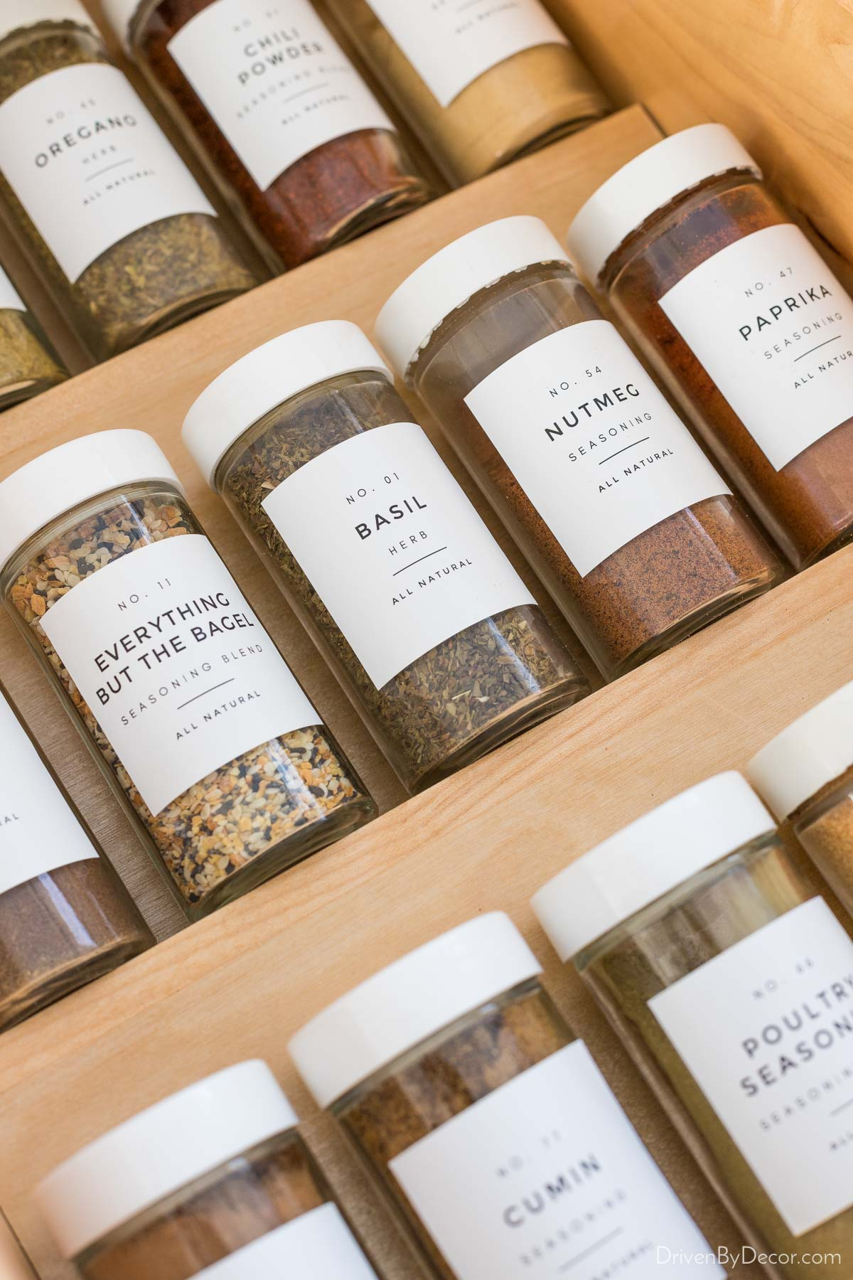 Spice jars with simple matching labels helped organize them in our kitchen drawers!