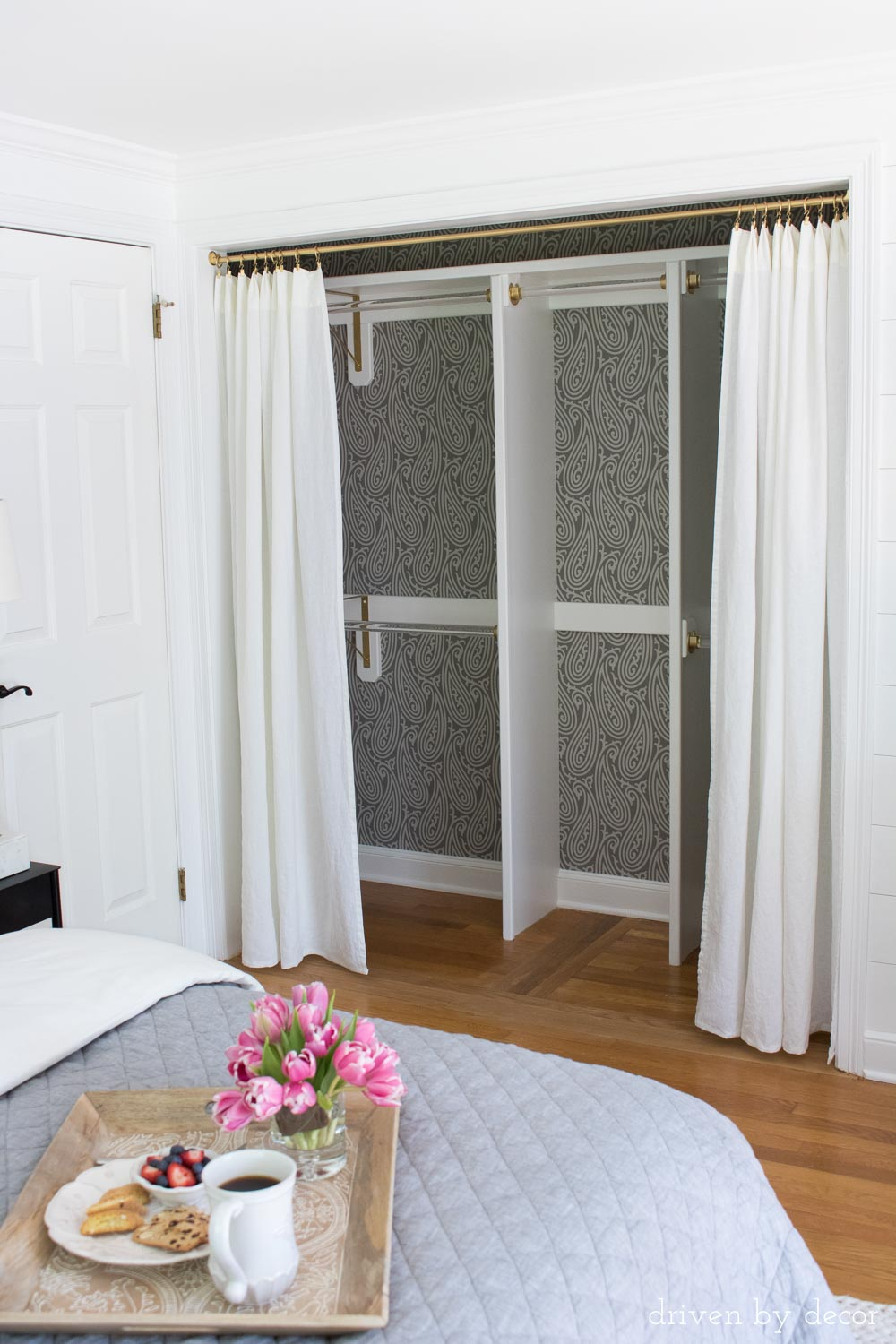 Love the idea of adding wallpaper to the back of a closet or pantry!
