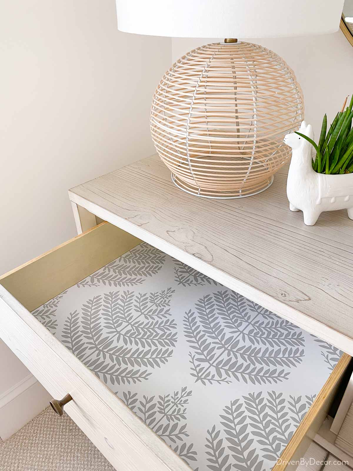 Love this wallpaper idea of using a favorite peel and stick wallpaper to line your drawers!
