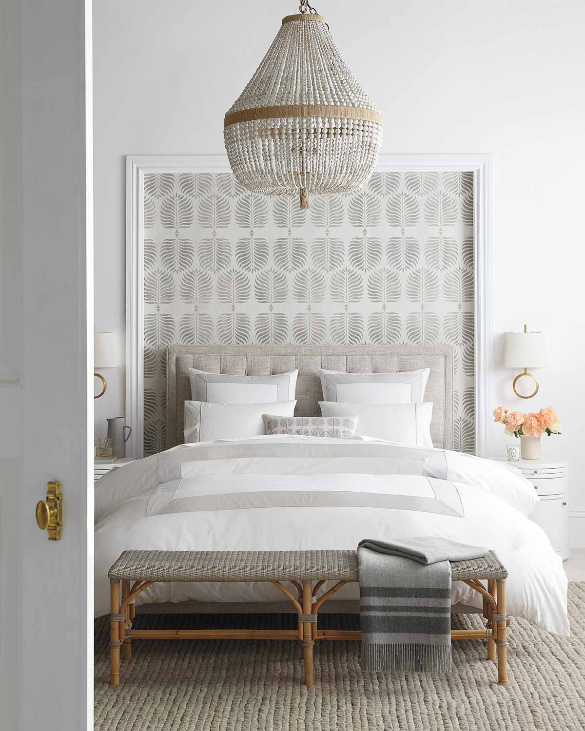 Love the idea of using wallpaper in a bedroom to frame the bed!