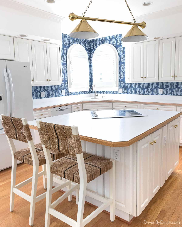 Wallpaper as an inexpensive alternative to backsplash tile - love this idea!