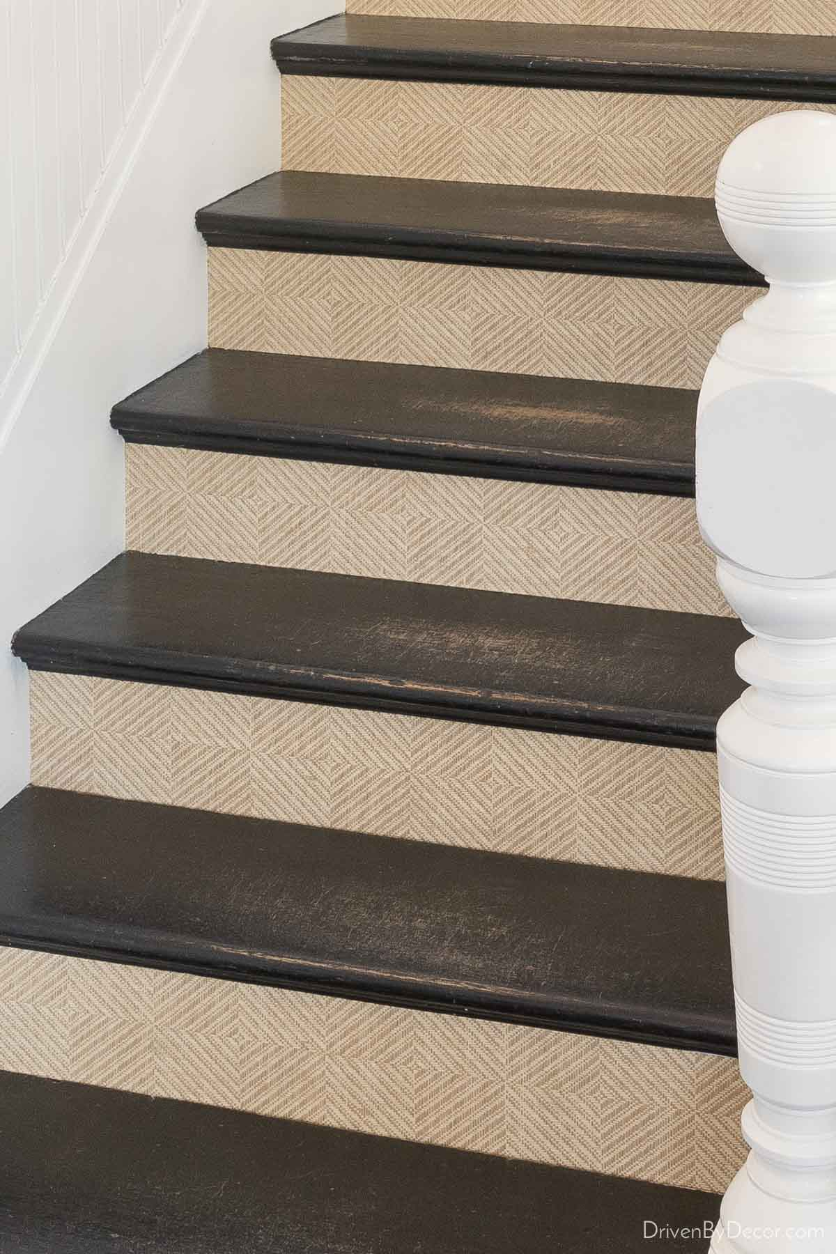 Patterned grasscloth wallpaper on the risers creates a beautiful staircase!