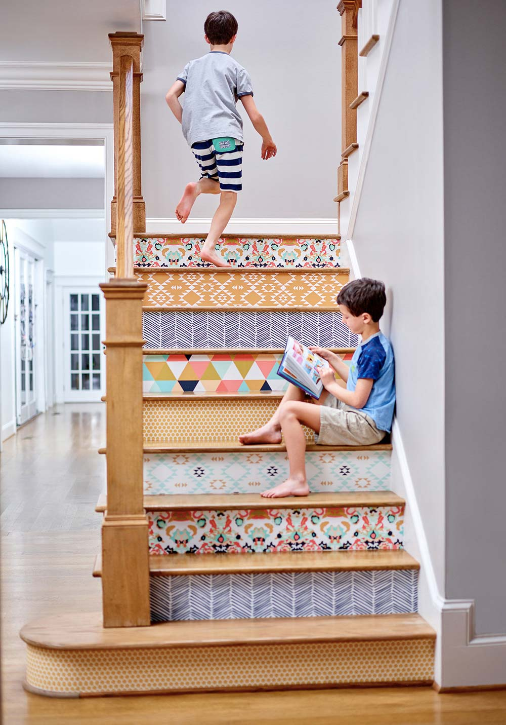 Wallpaper your stair risers for a fun pop of unexpected color and pattern